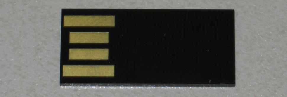 A monolithic USB thumb drive