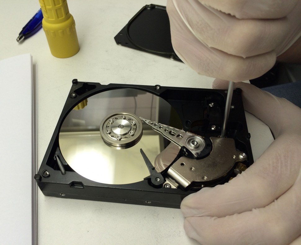 An engineer working on a hard drive in our clean room.