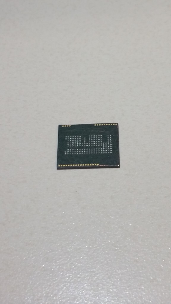 Flip side of NAND memory chip, note the circuitry.