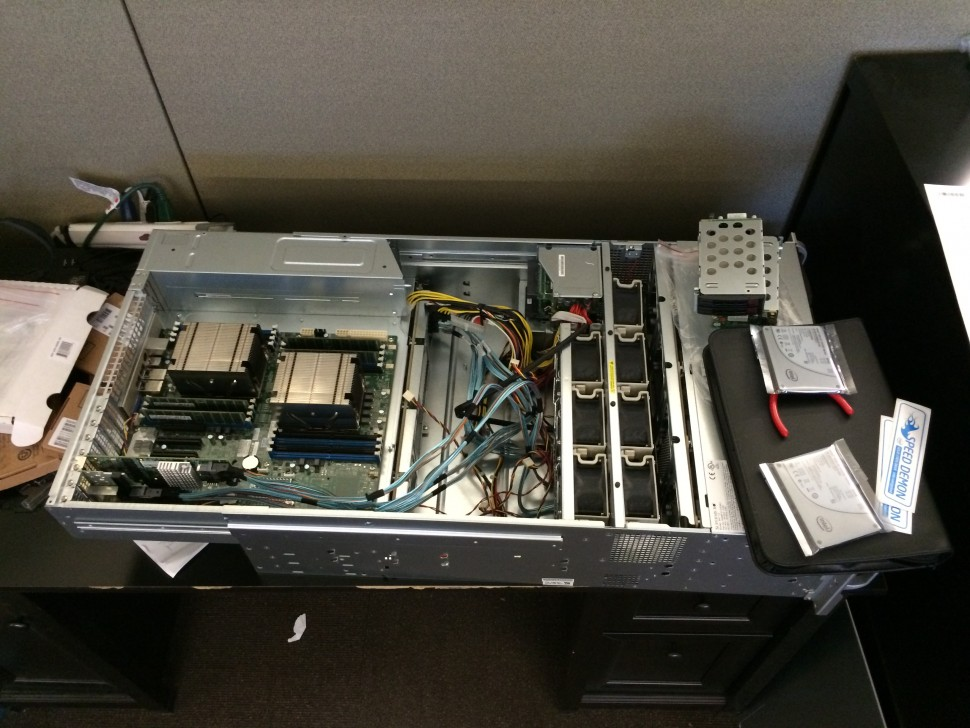The server mid-assembly in our office. The server contains 12 of the drives pictured earlier in a RAID 6 configuration for a total of 80TB of storage. The remaining four drives from the picture are set aside as spares. The server also contains two Intel SSDs (seen on the right side of this photo) in a RAID 1 configuration running the server's operating system.