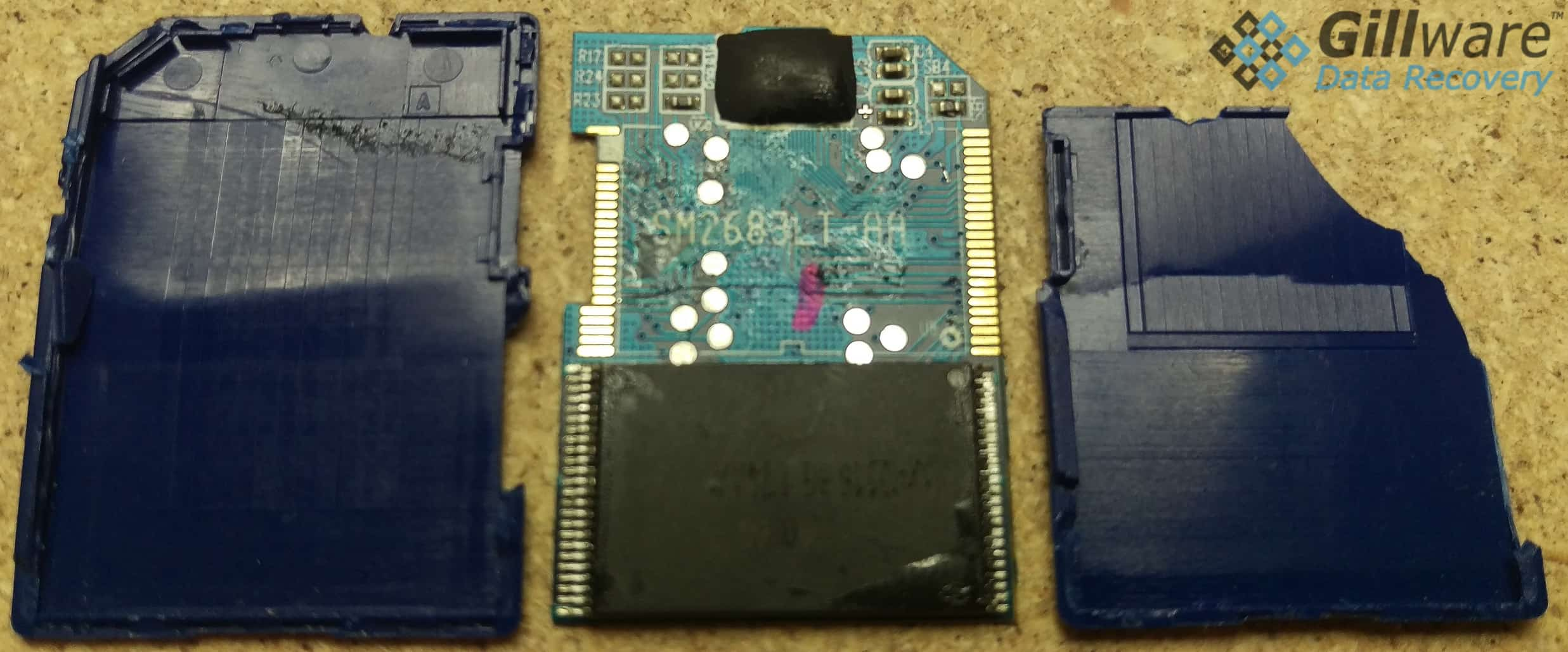 The inside of a damaged SD card. There is a visible crack in the PCB. Our SD card recovery service engineers were able to remove the NAND chip and extract its contents.