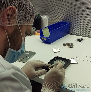 A cleanroom technician can recover hard drive data from a broken drive.