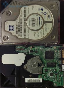 Front and back of hard drive with water damage
