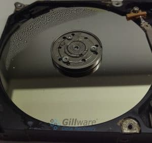 A water damaged hard drive. The platters will need to be carefully cleaned and dried in a data recovery lab.