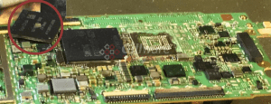 The chip successfully removed from the HTC One logic board (again, circled in red)