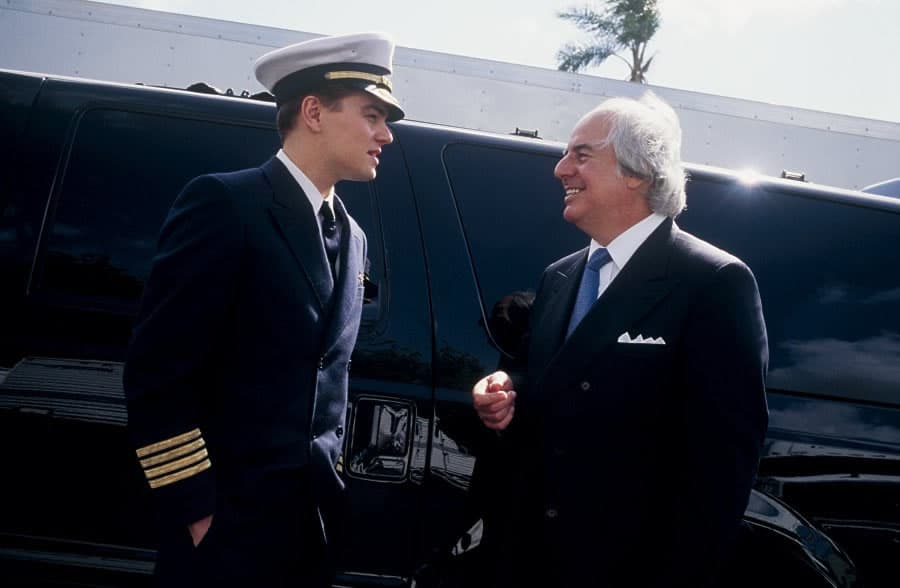 "Leonardo Dicaprio, playing infamous con man and forger Frank Abagnale, on the set of Steven Spielberg's ""Catch Me If You Can"" along with the real Frank Abagnale."