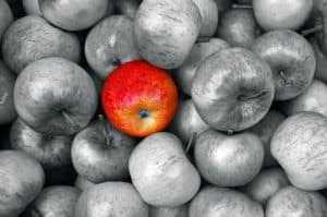 Red apple in grayscale image