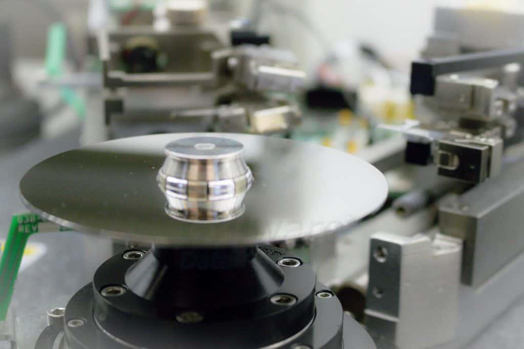 A hard disk platter in Gillware's burnishing machine