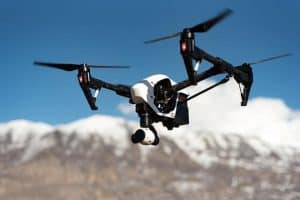 Drone flying near mountain range