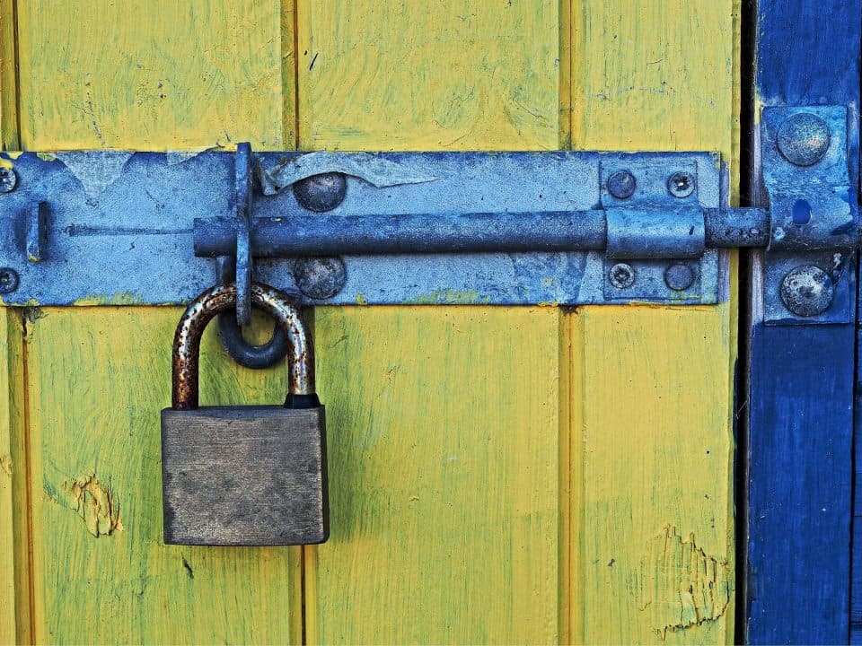 Padlock on barn door, representing how to safeguard against cyber attacks
