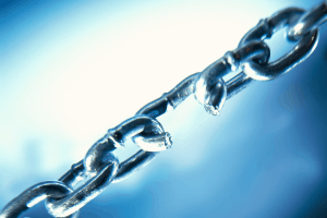 A photo of a chain with a broken link, symbolizing weak cybersecurity and information security.