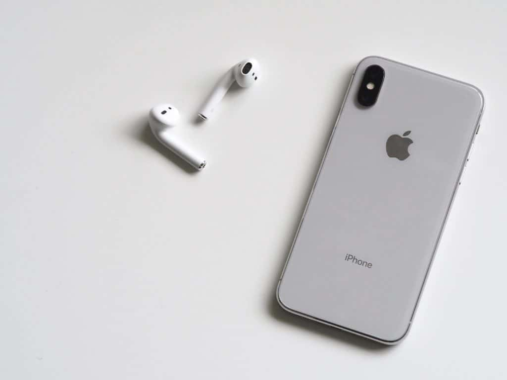 Silver iPhone with Airpods